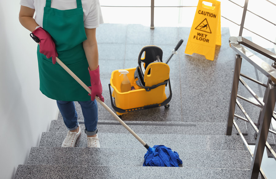 professional cleaner cleaning stairs